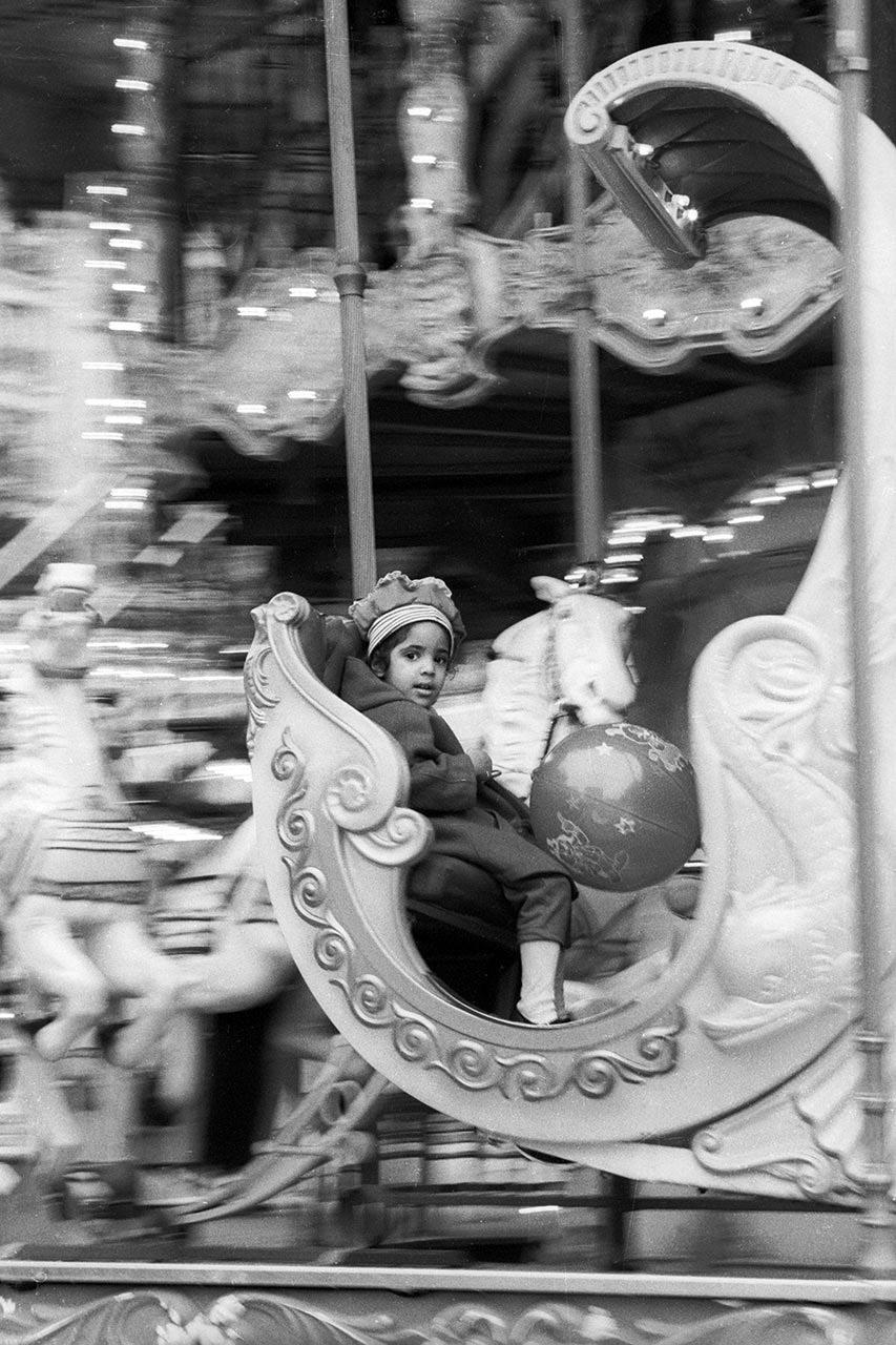 Girl on merry-go-round, Paris, 1992