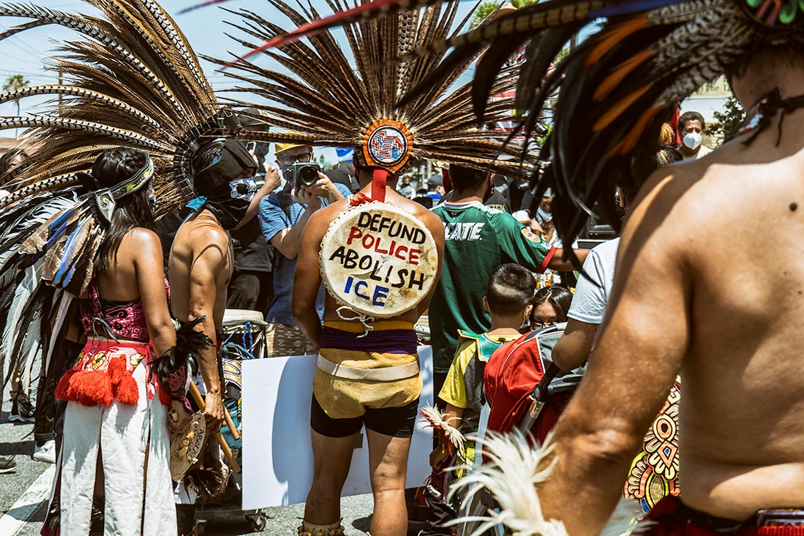 Indigenous Dancers lead the march